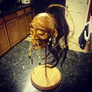 Shrunken head made from clay